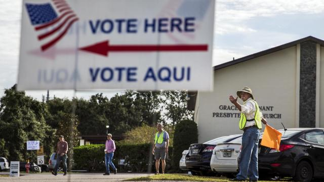 Volunteers direct traffic at a polling place on Election Day in Orlando, Fla., Nov. 6, 2018. In ending some of the harshest voting restrictions in the nation for those with criminal records, Florida voters responded to the argument that people should get another chance. (Scott McIntyre/The New York Times)