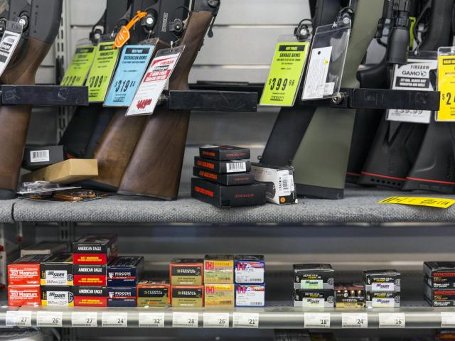 FILE -- Guns and ammunition are displayed for sale at a shop in Sacramento, Calif., on May 7, 2018. California, which already had some of the nation's toughest gun control laws, recently passed several new restrictions. (Andrew Burton/The New York Times)
