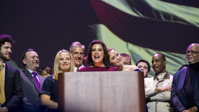 Gretchen Whitmer, a Democrat, is embraced by her daughter as she addresses the crowd after winning the governor's race, during an election night party at the MotorCity Casino Hotel in Detroit, Nov. 6, 2018. Whitmer defeated the state's Republican attorney general, Bill Schuette. (Brittany Greeson/The New York Times)