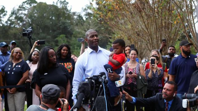 Holding his son Davis, Tallahassee Mayor Andrew Gillum, the Democratic candidate for governor, speaks to reporters after casting his ballot as his wife R. Jai looks on at left in Tallahassee, Fla., on Tuesday, Nov. 6, 2018. The Democratic party was in rebound mode in seven states the president won in 2016. They bounced back in some, but still face an uphill climb in others. (Gabriella Angotti-Jones/The New York Times)