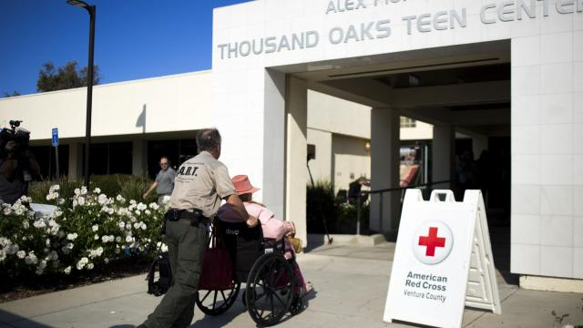 As the Woolsey Fire rages nearby, a volunteer with the city's Disaster Assistance Response Team brings an evacuee to an emergency shelter in Thousand Oaks, Calif., on Friday, Nov. 9, 2018. As wildfires swept over a large swath of California on Friday, the authorities said at least five people had been killed in a blaze that decimated a retirement community in the foothills of the Sierra Nevada. (Jenna Schoenefeld/The New York Times)