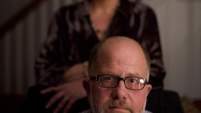 Jeffrey Draine, a retired Temple University professor who was diagnosed with early-onset Alzheimer's, and his wife, Debora Dunbar, at home in Wallingford, Pa., Nov. 7, 2018. Stigma often prevents patients from acknowledging an Alzheimer's diagnosis, but the tide may be changing; Draine hasn't regretted sharing his diagnosis with colleagues, family and friends. (Mark Makela/The New York Times)