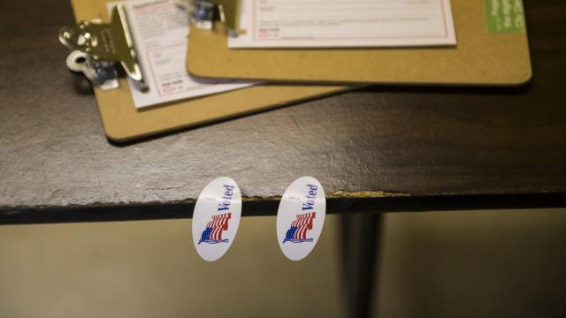 Stickers await voters at New Mt. Moriah Baptist Church in Highland Park, Mich., Nov. 6, 2018. Michigan was among several states where ballot measures passed that will make it easier to vote. (Brittany Greeson/The New York Times)
