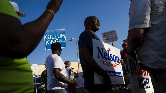 Protesters supporting incumbent Sen. Bill Nelson (D-Fla.), center, and Republican gubernatorial candidate Ron DeSantis, right, argue during a demonstration outside the office of the Broward County supervisor of elections in Lauderhill, Fla., on Friday, Nov. 9, 2018. Dusting off their playbook from 2000, Republicans claim the recount is rife with fraud. But what's driving them is their narrow majority in the Senate and their need to deliver a win to the base. (Scott McIntyre/The New York Times)