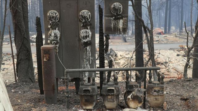 A utility meter panel that was melted in the flames of the Camp Fire in Paradise, Calif., is pictured on Monday, Nov. 12, 2018. Four days after a blaze called the Camp Fire ripped through the small town of Paradise, the sheriff's office said that more than 200 residents are still missing. (Jim Wilson/The New York Times)