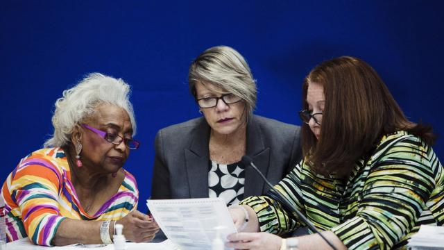 Brenda Snipes, the head of Broward County's elections office, left, Judge Betsy Benson, center, and Judge Deborah Carpenter-Toye look over a ballot during a canvassing board meeting at the Broward County Supervisor of Elections Office in Lauderhill, Fla., Nov. 9, 2018. Snipes, a Democrat, is at the center of a raging controversy marked by three statewide recounts, a litany of lawsuits, rising calls for her removal (the most recent from by the man who appointed her), — and a rowdy protest last week buoyed by the stinging words of President Donald Trump. (Scott McIntyre/The New York Times)