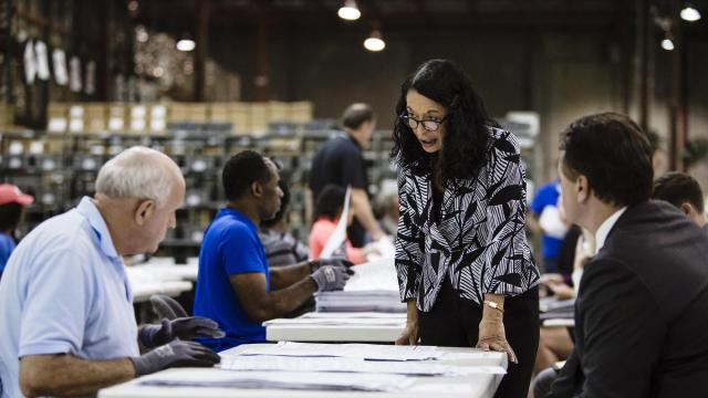 Susan Bucher, the Palm Beach County Supervisor of Elections, speaks to a voting technician as a lawyer looked on in Riviera Beach, Fla., Nov. 10, 2018. Old equipment in Palm Beach County has prompted the elections supervisor to warn the county may not be able to meet the deadline in Florida's statewide recount. (Scott McIntyre/The New York Times)