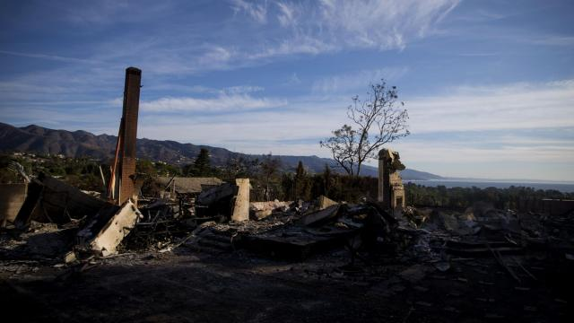 A destroyed home at Point Dume as firefighters work to contain the Woolsey Fire in Malibu, Calif., Nov. 13, 2018. The deadly wildfires that are devastating communities in parts of Northern and Southern California first ignited in an expanding part of the American landscape: not in forests, not in cities, but in the areas that experts call the wildland-urban interface. (Eric Thayer/The New York Times)