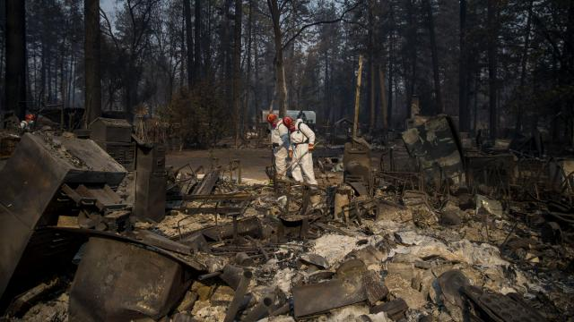 Search and rescue teams look for the remains of victims in the aftermath of the Camp Fire in Paradise, Calif., Nov. 16, 2018. The Butte County sheriff has revised a list of people described as missing to include 630 names, though he hoped that some who are wrongly classified as missing would report themselves safe. 63 people are confirmed dead. (Eric Thayer/The New York Times)
