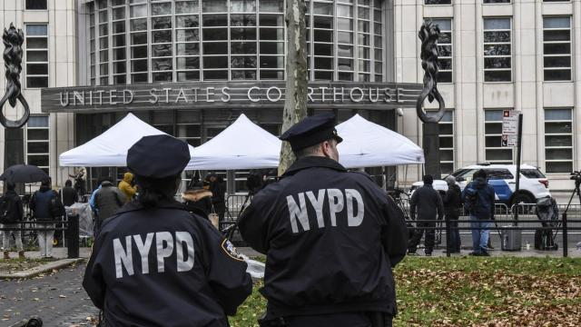 FILE -- Members of the NYPD patrol while reporters gather outside of the Brooklyn Federal Courthouse, where Joaquín Guzmán Loera, the Mexican drug lord known as El Chapo, is on trial, Nov. 13, 2018. A former operations chief in the Sinaloa drug cartel testified on Nov. 20, 2018, that he had personally bribed one of Mexico's top law-enforcement officials twice, each time delivering a briefcase stuffed with at least $3 million in cash. (Stephanie Keith/The New York Times)