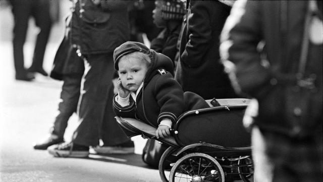 FILE -- A child watches the annual Macy's Thanksgiving Day Parade in New York, Nov. 22, 1973. It is a hard rite to explain: To commemorate the multicultural harvest feast of 1621 at Plymouth Rock, about three million New Yorkers and visitors annually station themselves on freezing late-November streets to watch giant inflatable branded cartoon characters, all promoting a department store that filed for bankruptcy protection more than 25 years ago. (Neal Boenzi/The New York Times)