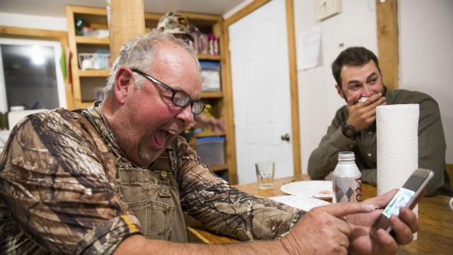 Ed Hughes, left, and Leland Brown laugh over old hunting stories after a successful elk hunt, at the Nature Conservancy's Zumwalt Prairie Preserve in Imnaha, Ore., Sept. 19, 2018. More and more hunters are making the transition to copper bullets amid mounting evidence that lead bullets are poisoning the wildlife that feed on carcasses and polluting the game meat that many people eat. (Max Whittaker/The New York Times)