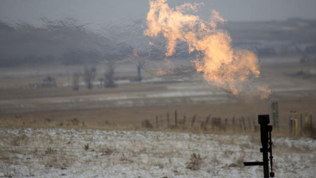 Flaring at an oil well near Williston, N.D., Nov. 8, 2018. Since his earliest days in office, President Trump has been taking steps that increase emissions of the heat-trapping greenhouse gases that are warming the planet to dangerous levels. (Janie Osborne/The New York Times)