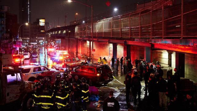 Law enforcement at the scene of a fatal car accident near Canal and Forsyth Streets in New York's Chinatown neighborhood, Nov. 26, 2018. A driver trying to park in Manhattan's bustling Chinatown careened over a curb and onto a sidewalk Monday night, killing one person and injuring six others, the authorities said. (James Keivom/The New York Times)