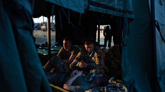 FILE-- U.S. Army soldiers relax in their tent at Base Camp Donna, one of multiple military bases being set up along the U.S.-Mexico border, in Donna, Texas, Nov. 8, 2018. The Pentagon is considering keeping active-duty American troops on the southwestern border into January 2019, two Defense Department officials said on NOV. 28, potentially extending a deployment to confront a caravan of migrants from Central America. (Tamir Kalifa/The New York Times)