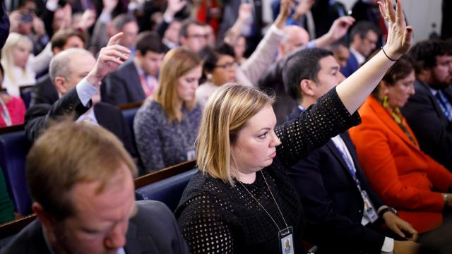 """Katie Rogers, a New York Times reporter, tries to get a question in during a press briefing at the White House in Washington, Nov. 27, 2018. Rogers tends to keep up with events on Twitter. """"I thought I was pretty much tethered to the news before, but this job requires you to imbibe a daily tidal wave of news,"""" she said. """"So that's fun."""" (Shen Ting/The New York Times)"""