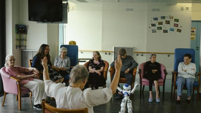 Patients watch a robot named Zora at Jouarre, a nursing facility an hour outside Paris, on Aug. 30, 2018. It may not look like much — more cute toy than futuristic marvel — but this robot is at the center of an experiment in France to change care for elderly patients. (Dmitry Kostyukov/The New York Times)