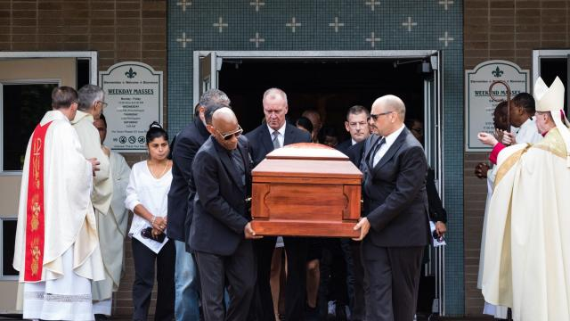 Freddy Cuevas, left, partner of Evelyn Rodriguez and father of Kayla Cuevas, carries the casket of Rodriguez with fellow pallbearers, at St. Anne's Roman Catholic Church, in Brentwood, N.Y., Sept. 21, 2018. Suffolk County authorities indicted a woman who first dismantled a memorial for Rodriguez's daughter, who was killed by gang members, and then ran over Rodriguez with her car. (Heather Walsh/The New York Times)