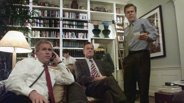 FILE -- George W. Bush, left, watches election results with his father, former President George H.W. Bush, and brother Jeb Bush in Washington, Nov. 7, 2000. When the son gives the eulogy for the father on Dec. 5, 2018, at Washington National Cathedral, it will bring to a close an extraordinary relationship unlike any in the annals of the American presidency. (Stephen Crowley/The New York Times)