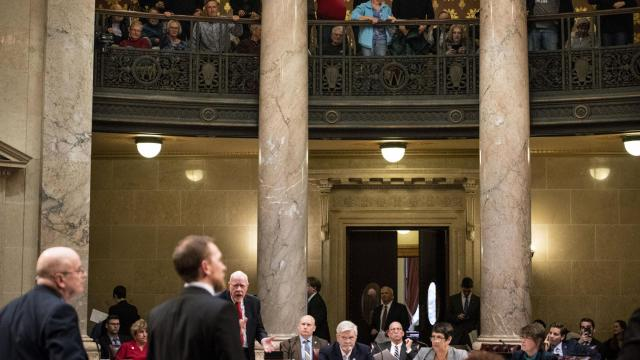 Members of the public yell in outrage after they are asked to leave the Wisconsin State Capitol in Madison as the Republican legislature planned votes that would limit the authority of its incoming Democratic governor, Tony Evers, Dec. 4 2018. Many deemed the package of bills being considered an unethical power grab that amounted to an unwillingness to accept the election outcome. (Lauren Justice/The New York Times)
