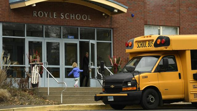 Outside Royle Elementary School in Darien, Conn., Nov. 30, 2018. What began as a small debate in the wealthy Connecticut town about parents eating lunch with their children at school erupted into a controversy over when Mom and Dad should let go. (Jessica Hill/The New York Times)