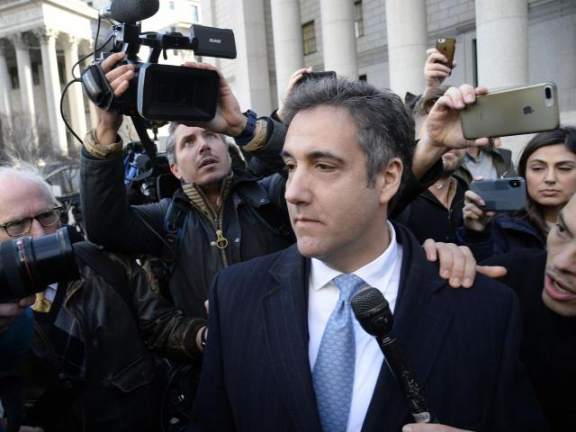 "FILE-- Michael Cohen, President Donald Trump's former lawyer, leaves federal court in Manhattan on Thursday morning, Nov. 29, 2018. Cohen should receive a ""substantial"" prison term of roughly four years, federal prosecutors in New York said on Dec. 7. Cohen has emerged as one of the biggest threats to Trump's presidency, providing the special counsel's office in Washington and prosecutors in Manhattan with material in dozens of hours of interviews. (Jefferson Siegel/The New York Times)"