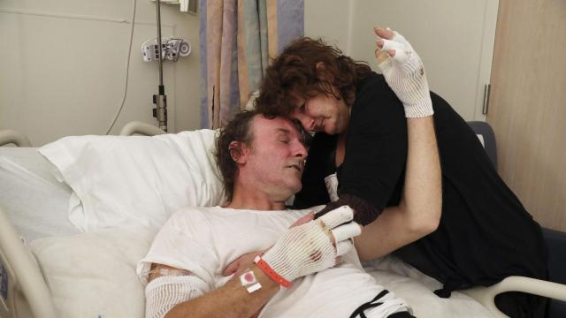 """Bill Blevins with his fiancée, Mary Sykes, in the burn unit at the UC Davis Medical Center in Sacramento, Calif., Nov. 30, 2018. California's devastating wildfire, known as the Camp Fire, may be over, but severe burn victims like Blevins """"live that nightmare every day."""" (Jim Wilson/The New York Times)"""