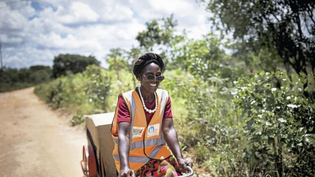 A image provided by Toby Madden/Transaid shows Josephine Mupeta, a volunteer health worker on a bicycle ambulance carrying supplies for identifying and treating malaria, in Serenje, Zambia. A multipronged program to combat malaria in remote villages has cut child mortality rates from the disease by 96 percent. (Toby Madden/Transaid via The New York Times) -- NO SALES; FOR EDITORIAL USE ONLY WITH NYT STORY SCI-CHILDREN-MALARIA BY DONALD G. MCNEIL JR. FOR DEC. 11, 2018. ALL OTHER USE PROHIBITED.