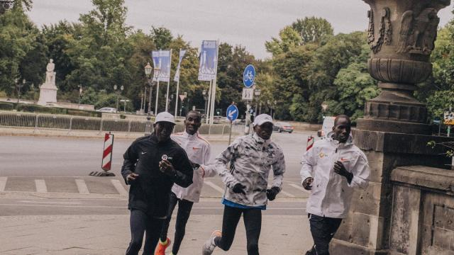 FILE -- Eliud Kipchoge, left, trains in his Nike Vaporfly 4% running shoes with fellow runners at the Tiergarten in Berlin, Sept. 13, 2018. Wearing the shoes makes runners more efficient than wearing other shoes, although not for the reasons many runners might expect. (Mustafah Abdulaziz/The New York Times)