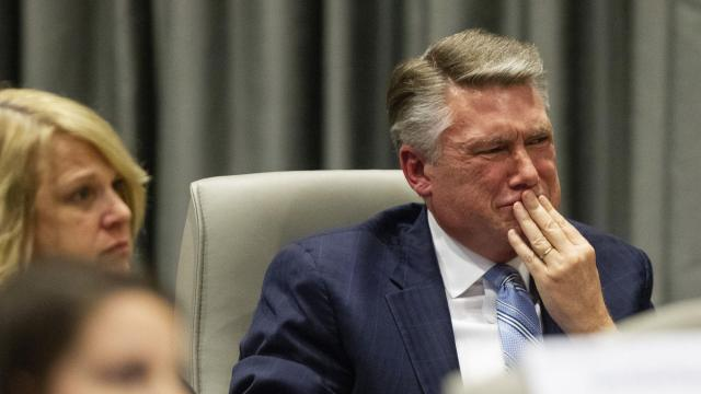 Mark Harris fights back tears as his son John Harris testifies during a public hearing before the North Carolina State Board of Elections in Raleigh, N.C., Feb. 20, 2019. Harris testified that he had warned his father, the Republican candidate in North Carolina's ninth Congressional district, in April 2017 about his misgivings over L. McCrae Dowless Jr., a campaign operative. (Travis Long/Pool via The New York Times)