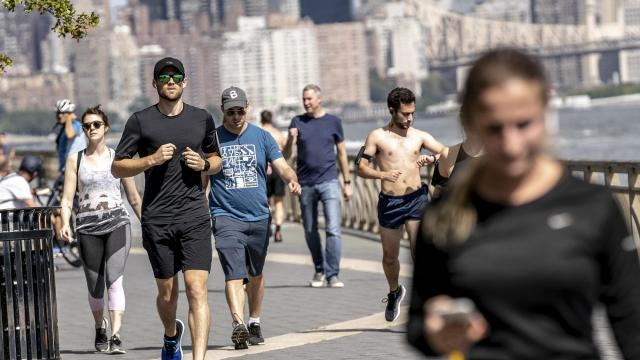 FILE — Joggers at East River Park in New York, Sept. 22, 2018. A new study that tracked how much people ate and moved after starting to exercise found that many of the people failed to lose or even gained weight while exercising. (Jeenah Moon/The New York Times).