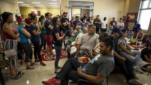 Dozens of people watch news coverage of the mass shooting while waiting to donate at a blood bank in El Paso, Texas, Saturday, Aug. 3, 2019. A gunman armed with a powerful assault-style rifle turned a crowded Walmart store into a scene of chaos and bloodshed in an attack that left at least 20 people dead and 26 others wounded, authorities said. (Adriana Zehbrauskas/The New York Times)