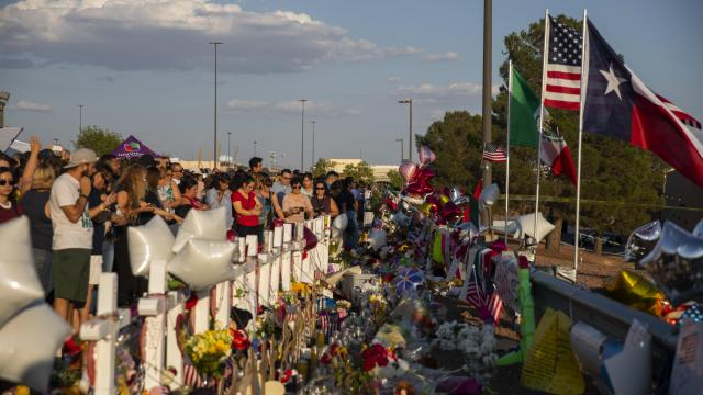 """People gather at a makeshift memorial for victims of a mass shooting at a Walmart in El Paso, Texas, Aug. 6, 2019. The suspect in the El Paso shooting stepped out of a vehicle with his hands up and declared """"I'm the shooter"""" when he was arrested minutes after the massacre at a Walmart store that killed 22 people, the police said in an affidavit filed Aug. 9. (Calla Kessler/The New York Times)"""