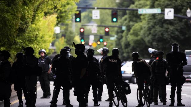 Police officers in Portland, Ore., on Saturday, Aug. 17, 2019. Hundreds of people gathered on Saturday for a rally at a waterfront park in Portland, Ore., where far-right groups faced off with anti-fascist counterprotesters and brought much of the downtown area to a standstill. (Ruth Fremson/The New York Times)