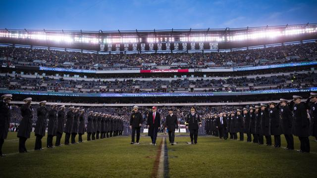 President Donald Trump takes the field during halftime at the Army-Navy football game, at Lincoln Financial Field in Philadelphia, Dec. 14, 2019. United States military officials said they were investigating whether Army cadets and Navy midshipmen had flashed hand symbols associated with hate groups at their football game on Saturday. (Al Drago/The New York Times)