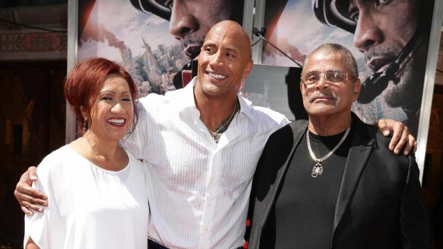 Ata Johnson, Dwayne Johnson and Rocky Johnson seen at Dwayne Johnson's Hands and Footprints Ceremony held at TCL Chinese Theatre on Tuesday, May 19, 2015, in Hollywood. (Photo by Eric Charbonneau/Invision for Warner Bros./AP Images)