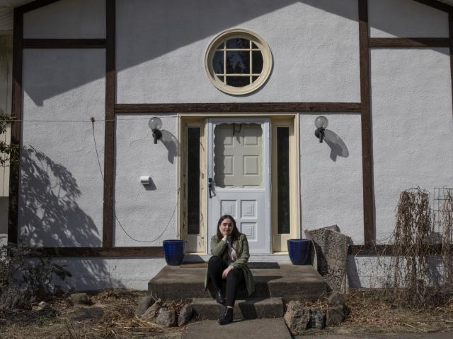 Casey DeSimone at her home in New Paltz, N.Y., where she self-quarantined for 14 days after returning from studying in Italy, March 18, 2020. Americans returning from Italy and Spain say border control officials didn't screen them or tell them to isolate themselves. (Lauren Lancaster/The New York Times)