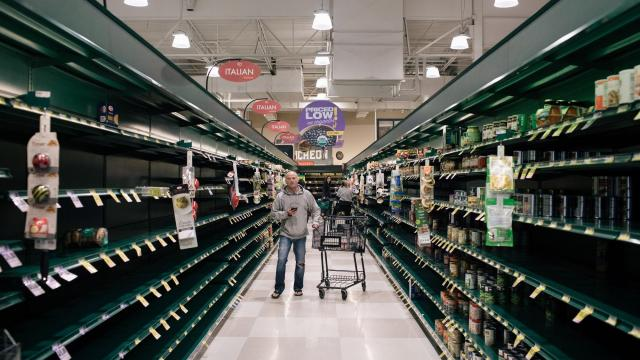 A man looks for canned goods in a nearly empty aisle at a Harris Teeter store in Arlington, Va., Monday, March 16, 2020, as people stock up in the wake of the cornavirus. (Alyssa Schukar/The New York Times)