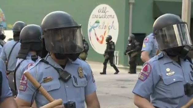 Raleigh police in riot gear begin filtering out to join the crowd