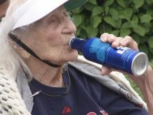 103-year-old survives coronavirus, celebrates with beer