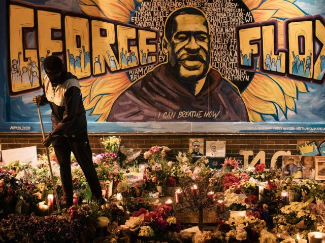 People gather at the makeshift memorial, Tuesday, June 2, 2020, where George Floyd died in Minneapolis. The death of Floyd, an African-American man, in Minneapolis police custody, has ignited protests across the country. (Alyssa Schukar/The New York Times)
