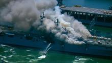 IMAGE: Firefighter crews battle blaze, 18 sailors injured, after fire erupts on Navy ship in San Diego