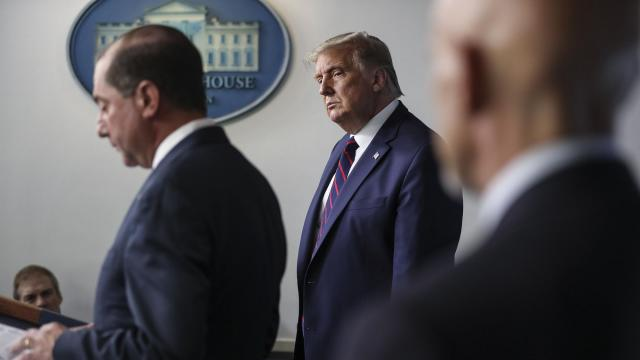 President Donald Trump listens as Human Services Secretary Alex Azar spoke at the White House in Washington, Aug. 23, 2020. A controversial guideline saying that people without COVID-19 symptoms didn't need to get tested was reportedly not written by CDC scientists, and was posted to the CDC's website in August by HHS officials. (Oliver Contreras/The New York Times)
