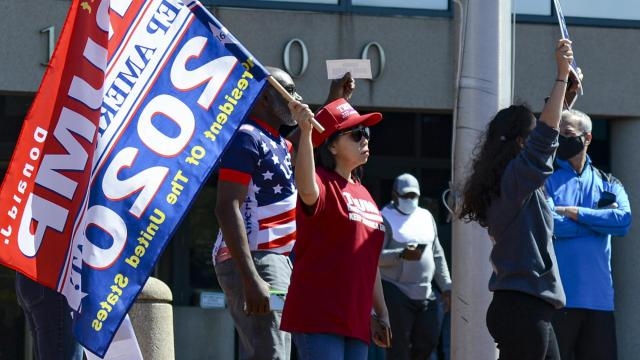 FILE -- Supporters of President Donald Trump outside of the Fairfax County Government Center in Fairfax, Va., disrupted early voting on Sept. 19, 2020. President Donald Trump on Tuesday raised dark and baseless descriptions of the city's voting process. (Kenny Holston/The New York Times)