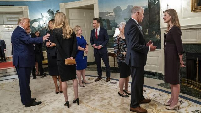 FILE -- President Donald Trump and first lady Melania Trump with Sen. Kelly Loeffler (R-Ga.), left, and Sen. Thom Tillis (R-N.C.) with Judge Amy Coney Barrett, right, at a reception on the day of Barrett's nomination inside the White House in Washington, Sept. 26, 2020. Sen. Josh Hawley (R-Mo.) is at center. Two weeks after the Centers for Disease Control and Prevention took down a statement about airborne transmission of the coronavirus, the agency on Monday replaced it with language citing new evidence that the virus can spread beyond six feet indoors. (Doug Mills/The New York Times).