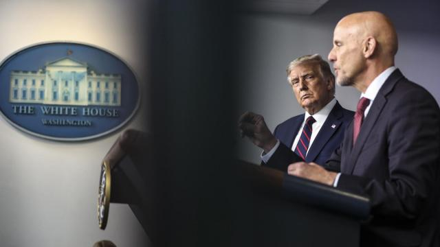 FILE — President Donald Trump watches Stephen Hahn, Food and Drugs commissioner, during a news conference announcing an emergency use authorization of a plasma treatment for COVID-19, at the White House in Washington, Aug. 23, 2020. Emergency-use authorizations, a formerly obscure corner of regulatory law, have become a centerpiece of the government's response to the coronavirus pandemic. (Oliver Contreras/The New York Times)