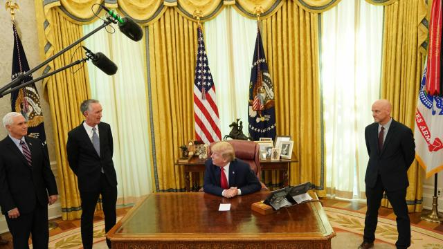 FILE - President Donald Trump with, from left, Vice President Mike Pence, Daniel O'Day, CEO of Gilead, and Stephen Hahn, FDA commissioner, in the Oval Office at the White House in Washington, May 1, 2020. Remdesivir, the only antiviral drug authorized for treatment of COVID-19 in the U.S., made by Gilead, fails to prevent deaths among patients, according to a study of more than 11,000 people sponsored by the World Health Organization. (Erin Schaff/The New York Times)