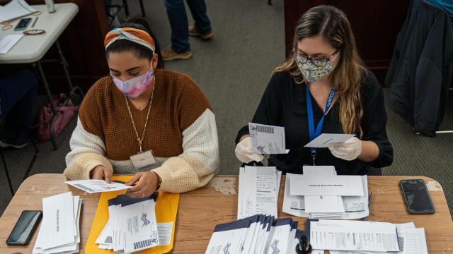 Workers sort ballots, Nov. 4, 2020 in Pennsylvania. (Robert Nickelsberg/The New York Times)