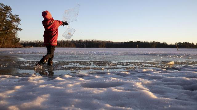 FILE -- A boy plays on the frozen lake at Wintergreen Dogsled Lodge outside of Ely, Minn., on Friday, April 19, 2019. New research, published on Wednesday, Nov. 18, 2020, in the journal PLoS One, on the connection between climate change and winter drownings has found that reported drowning deaths are increasing exponentially in areas with warmer winters. (Tim Gruber/The New York Times)