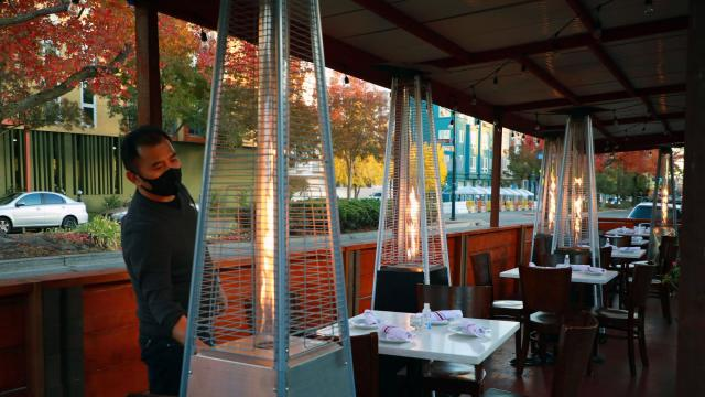 Patio heaters at a restaurant in Berkeley, Calif., on Nov. 19, 2020. (Jim Wilson/The New York Times)